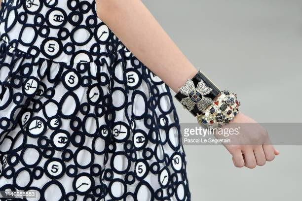 A model bracelet detail walks the runway during Chanel Cruise 2020 Collection at Le Grand Palais on May 03 2019 in Paris France