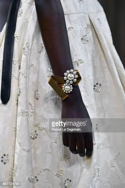 A model bracelet detail walks the runway during the Miu Miu Paris show as part of the Paris Fashion Week Womenswear Spring/Summer 2018 on October 3...