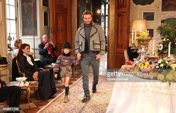 Model Brad Kroenig and his son Hudson Kroenig walk the runway during the Chanel Metiers d'Art Collection 2014/15 ParisSalzburg on December 2 2014 in...