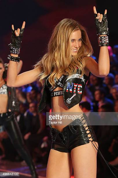 Model Bridget Malcolm walks the runway during the 2015 Victoria's Secret Fashion Show at Lexington Avenue Armory on November 10 2015 in New York City