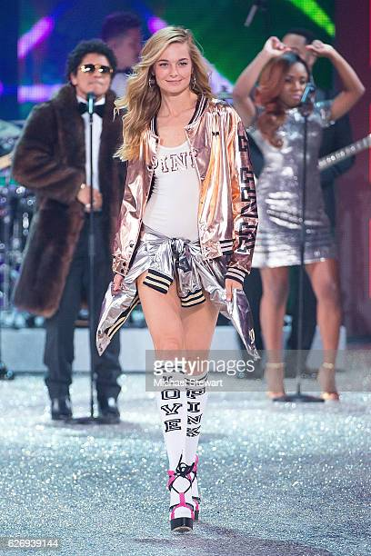 Model Bridget Malcolm walks the runway during the 2016 Victoria's Secret Fashion Show at Le Grand Palais in Paris on November 30 2016 in Paris France