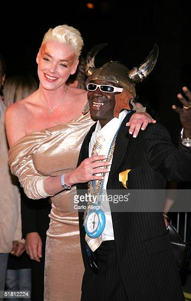 Model Brigitte Nielsen and rapper Flavor Flav attend the VH1 Big in '04 at the Shrine Auditorium December 1 2004 in Los Angeles California