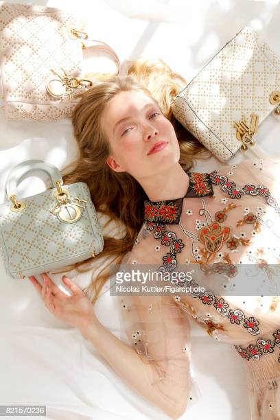 Model Britt Fox poses at a fashion shoot for Madame Figaro on June 9, 2017 in Paris, France. Dress and Lady Dior bags . PUBLISHED IMAGE. CREDIT MUST...