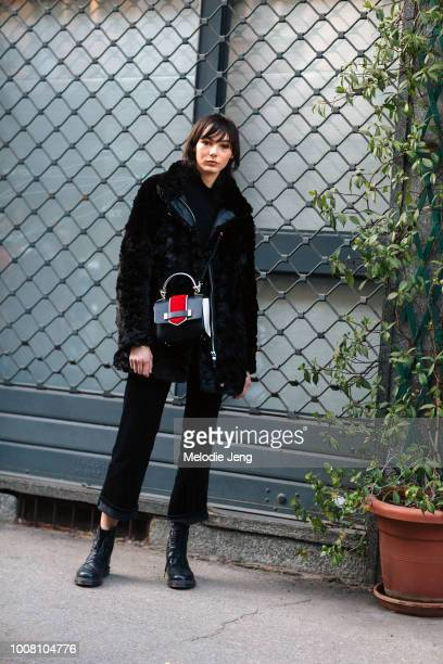 Model Bronte Coates wears all black a shaggy coat cuffed jeans and boots during Milan Men's Fashion Week Fall/Winter 2017/18 on January 15 2017 in...