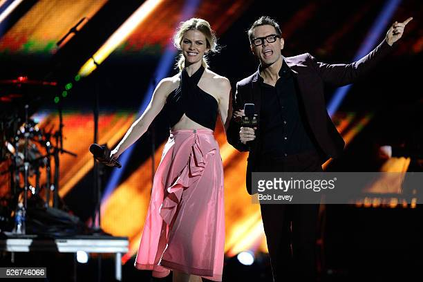 Model Brooklyn Decker and radio personality Bobby Bones speak onstage during the 2016 iHeartCountry Festival at The Frank Erwin Center on April 30...