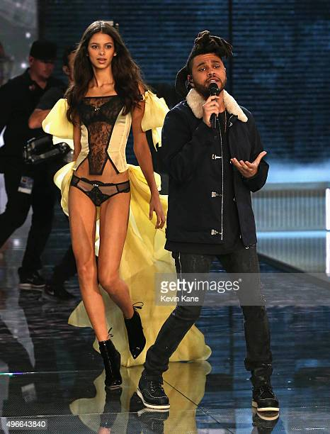 Model Bruna Lirio from Brazil walks the runway walks while singer The Weeknd performs during the 2015 Victoria Secret Fashion Show at Lexington...