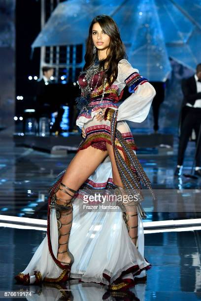 Model Bruna Lirio walks the runway during the 2017 Victoria's Secret Fashion Show In Shanghai at MercedesBenz Arena on November 20 2017 in Shanghai...