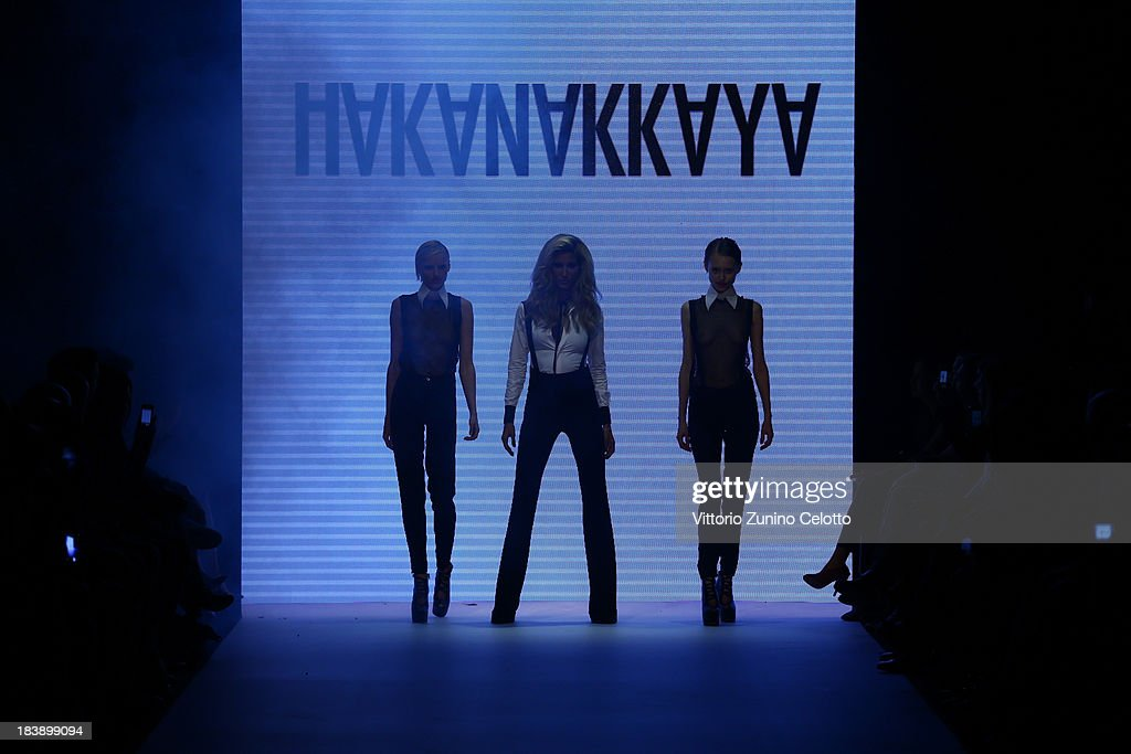 Model Cagla Sikel (C) and models walk the runway at the Hakan Akkaya show during Mercedes-Benz Fashion Week Istanbul s/s 2014 presented by American Express on October 9, 2013 in Istanbul, Turkey.