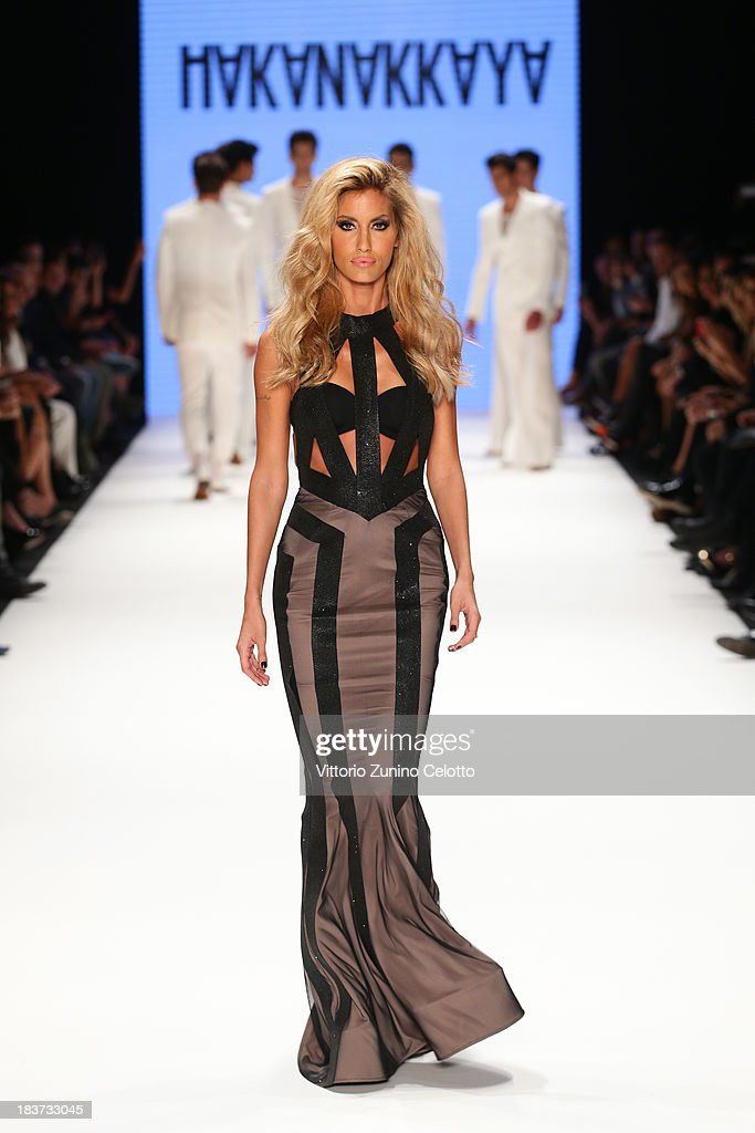 Model Cagla Sikel walks the runway at the Hakan Akkaya show during Mercedes-Benz Fashion Week Istanbul s/s 2014 presented by American Express on October 9, 2013 in Istanbul, Turkey.