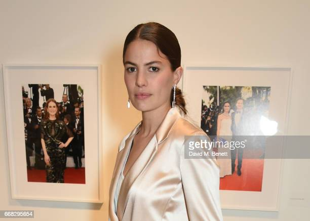 Model Cameron Russell attends as Vogue Chopard open Glittering Prizes a photo exhibition by Ivan Shaw celebrating 70 years of the red carpet at the...