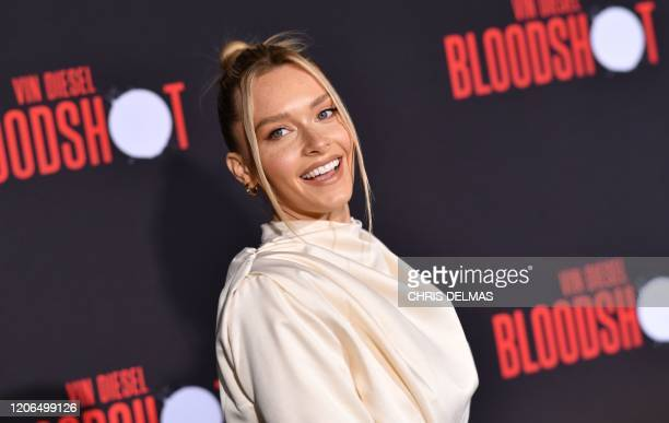 US model Camille Kostek arrives for the premiere of Sony's Bloodshot at the Regency Village theatre on March 10 2020 in Westwood California