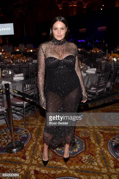 Model Candice Huffine attends as Moet Chandon Toasts to the amfAR New York Gala At Cipriani Wall Street at Cipriani Wall Street on February 8 2017 in...
