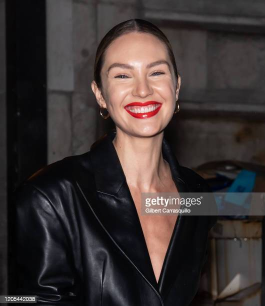 Model Candice Swanepoel is seen leaving the Oscar De La Renta Fashion Show during New York Fashion Week at The New York Public Library on February 10...