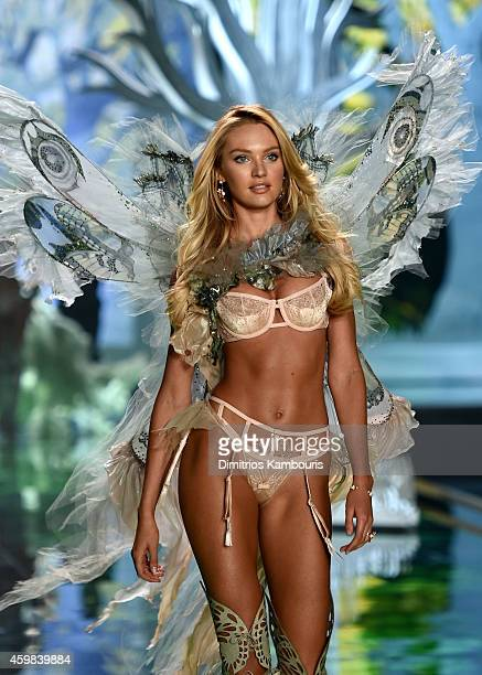 Model Candice Swanepoel walks the runway during the 2014 Victoria's Secret Fashion Show at Earl's Court Exhibition Centre on December 2 2014 in...