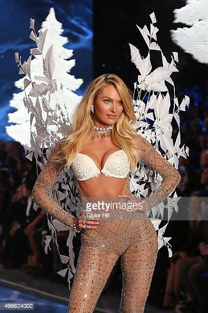 Model Candice Swanepoel walks the runway during the 2015 Victoria's Secret Fashion Show at Lexington Avenue Armory on November 10 2015 in New York...