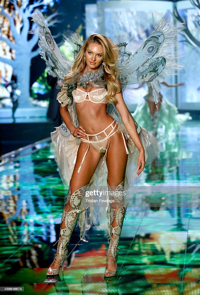 Model Candice Swanepoel wears Victoria's Secret Designer Collection Bra, Garter Belt and Matching Panty with Swarovski crystals, Hand Dyed Tulle and Chiffon Wings and Neck Piece on the runway at the 2014 Victoria's Secret Runway Show - Swarovski Crystal Looks at Earl's Court Exhibition Centre on December 2, 2014 in London, England.