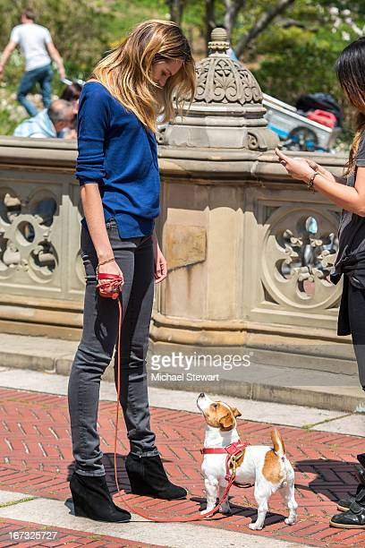 Model Candice Swanepoel with her dog Milo during a photo shoot for Victoria's Secret in Central Park on April 24 2013 in New York City