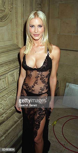 Model Caprice wearing a 800 Versace lace dress attends the National TV Awards at the Royal Albert Hall on October 8 1996 in London