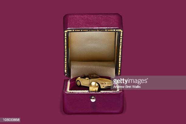 Model car inside an open pink jewellery box
