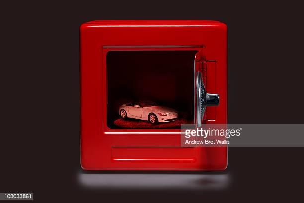 model car inside an open red safe