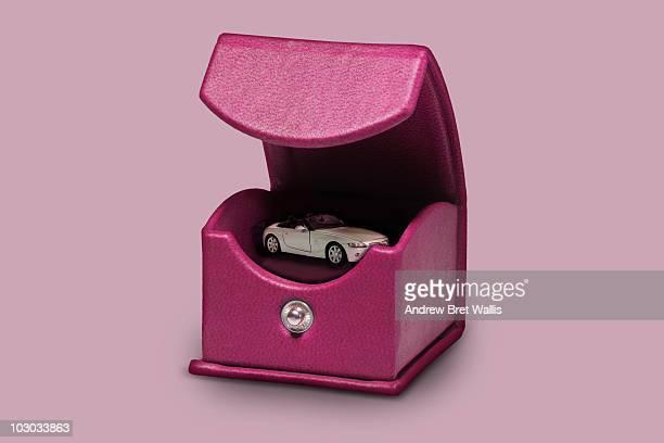model car inside an opened pink jewellery box