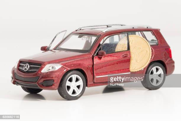 Model car is seen with Euro currency units.