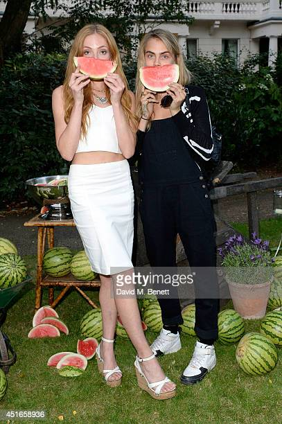 Model Cara Delevingne and Clara Paget attend the Club Monaco Garden Party hosted by Quentin Jones Clara Paget and Annie Morris in Eaton Square on...