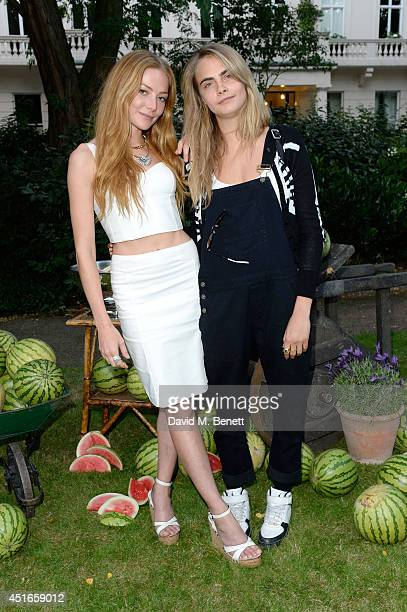 Model Cara Delevingne and Clara Paget attend the Club Monaco Garden Party hosted by Quentin Jones, Clara Paget and Annie Morris in Eaton Square on...