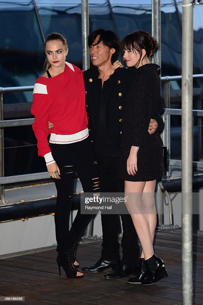 Model Cara Delevingne (L) and Dakota Johnson are seen at the Chanel yacht party at Chelsea Pier on March 30, 2015 in New York City.