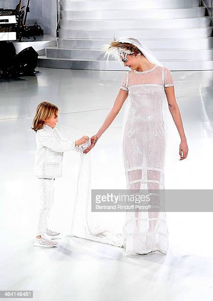 Model Cara Delevingne and god son of Karl Lagerfeld Hudson Kroenig walk the runway during the Chanel show as part of Paris Fashion Week HauteCouture...