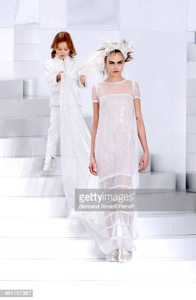Model Cara Delevingne and godson of Karl Lagerfeld Hudson Kroenig walk the runway during the Chanel show as part of Paris Fashion Week HauteCouture...