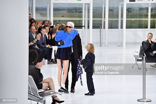 Model Cara Delevingne and Hudson Kroenig greet the Designer Karl Lagerfeld during the Chanel show as part of the Paris Fashion Week Womenswear...