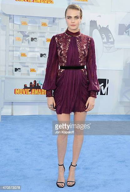 Model Cara Delevingne arrives at the 2015 MTV Movie Awards at Nokia Theatre LA Live on April 12 2015 in Los Angeles California
