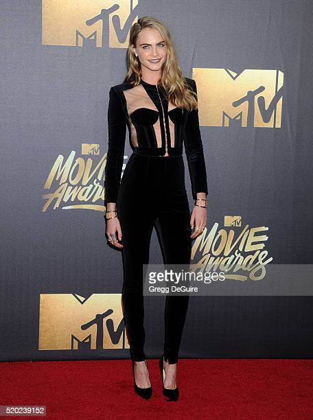 Model Cara Delevingne arrives at the 2016 MTV Movie Awards at Warner Bros Studios on April 9 2016 in Burbank California