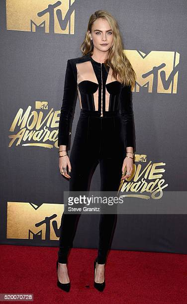 Model Cara Delevingne attends the 2016 MTV Movie Awards at Warner Bros Studios on April 9 2016 in Burbank California MTV Movie Awards airs April 10...