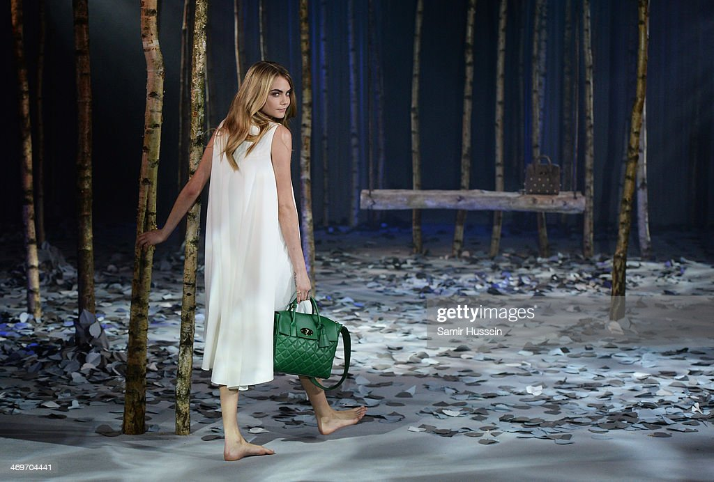 Model Cara Delevingne poses at a photocall to launch the Mulberry Cara Delevingne Collection during London Fashion Week at Claridge's Hotel on February 16, 2014 in London, England.