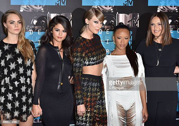 Model Cara Delevingne recording artists Selena Gomez and Taylor Swift actress Serayah McNeill and actress Mariska Hargitay arrive to the 2015 MTV...