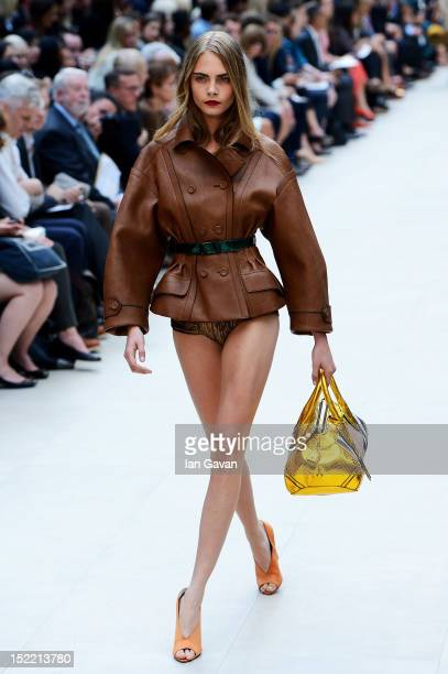 Model Cara Delevingne showcases designs on the catwalk by Burberry Prorsum on day 4 of London Fashion Week Spring/Summer 2013 at Kensington Gardens...