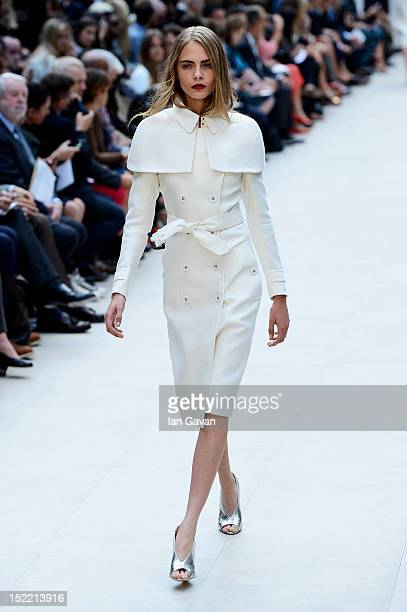 Model Cara Delevingne showcases designs on the catwalk by Burberry Prorsum on day 4 of London Fashion Week Spring/Summer 2013, at Kensington Gardens...