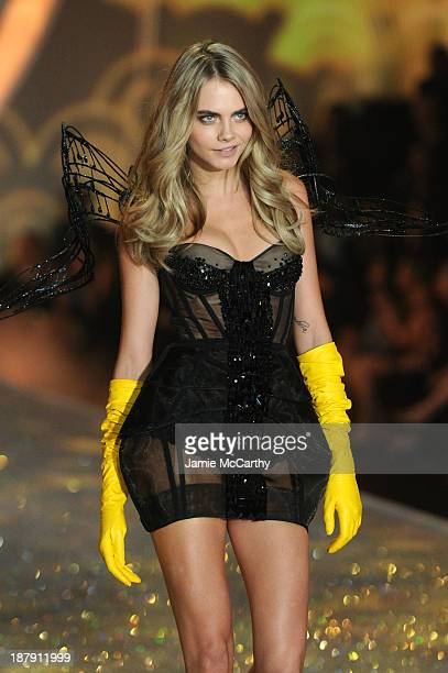 Model Cara Delevingne walks the runway at the 2013 Victoria's Secret Fashion Show at Lexington Avenue Armory on November 13 2013 in New York City