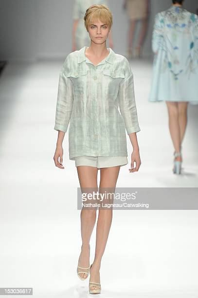 99c9cc2c795 Model Cara Delevingne walks the runway at the Cacharel Spring Summer 2013  fashion show during Paris