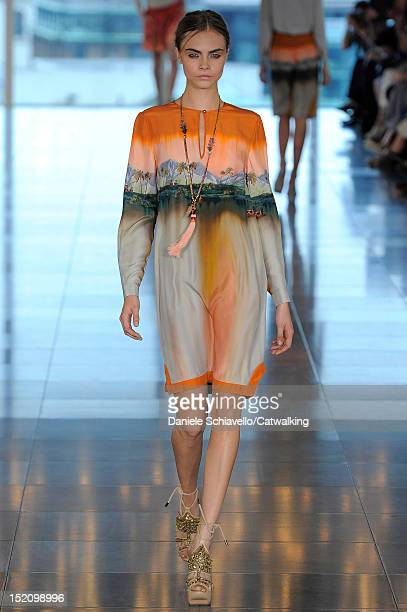 Model Cara Delevingne walks the runway at the Matthew Williamson Spring Summer 2013 fashion show during London Fashion Week on September 16, 2012 in...