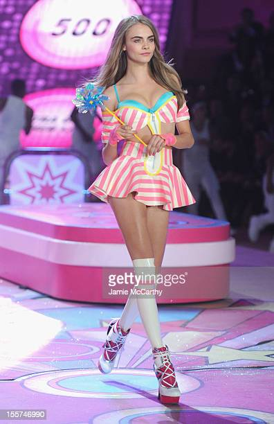 Model Cara Delevingne walks the runway during the 2012 Victoria's Secret Fashion Show at the Lexington Avenue Armory on November 7 2012 in New York...