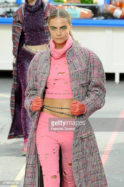 Model Cara Delevingne walks the runway during the Chanel show as part of the Paris Fashion Week Womenswear Fall/Winter 20142015 on March 4 2014 in...