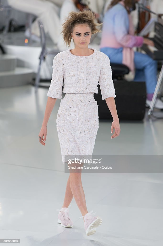 Model Cara Delevingne walks the runway during the Chanel show as part of Paris Fashion Week Haute-Couture Spring/Summer 2014, at Grand Palais in Paris.