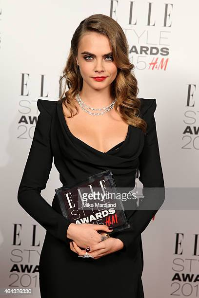 Model Cara Delevingne, winner of the Breakthrough Actress Award, poses in the winners room during the Elle Style Awards 2015 at Sky Garden @ The...