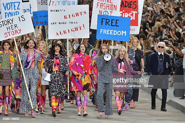Model Cara Delevingne with Karl Lagerfeld and Models walk the runway during the Chanel show as part of the Paris Fashion Week Womenswear...