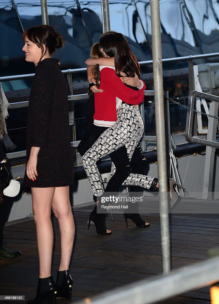 Model (L) Cara Delevingne(R)Dakota Johnson and Kendall Jenner are seen Chanel Party on Yacht at Chelsea Pier on March 30, 2015 in New York City. Photo by Raymond Hall/GC Images)