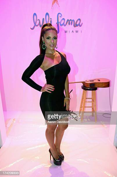 Model Carissa Rosario attends the Luli Fama show during Mercedes-Benz Fashion Week Swim 2014 at Cabana Grande at the Raleigh on July 21, 2013 in...