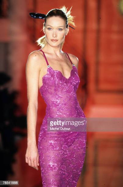 PARIS Model Carla Bruni walks the catwalk at Versace High Fashion show in Paris France According to reports December 18 2007 French President Nicolas...